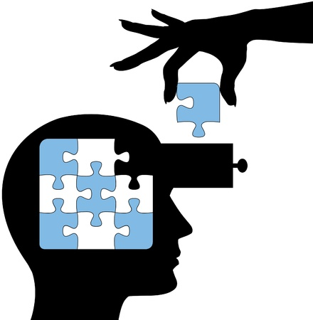 education concept: Hand puts the solution to a puzzle into the mind of a learning person