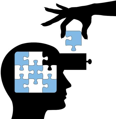cassettiera: Mano mette la soluzione a un puzzle nella mente di una persona di apprendimento