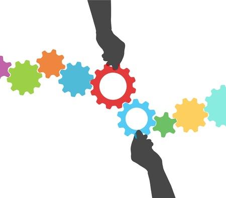 engrenages: Les mains des gens d�tiennent des engrenages color�s aux mailles de deux lignes de la gestion de projet technique