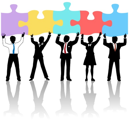 Equipo de personas de negocios colaboren levantando piezas de puzzle como una solución a un problema Foto de archivo - 12853013