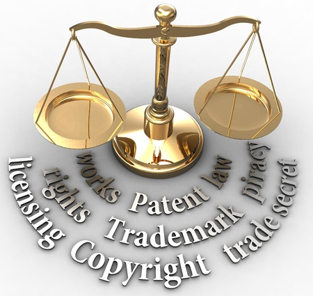 trademark: Scale with intellectual property concepts of patent copyright trademarks Stock Photo