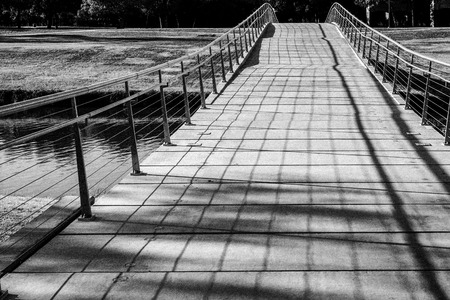 shadowed: Lonely Bridge Stock Photo