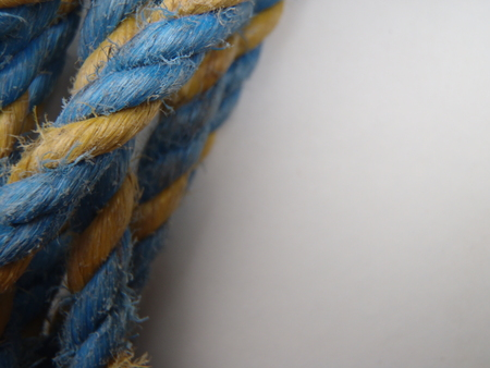 Blue and yellow rope on a white background Imagens