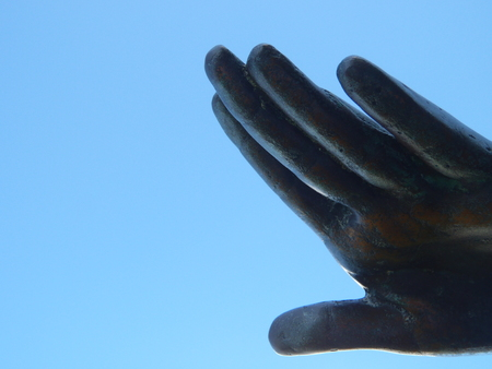 Hand of a statue on a sky background