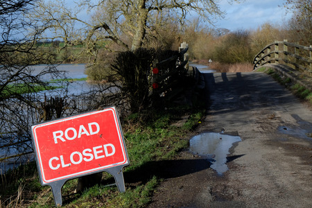 ouse: Road closed due to flooding of the River Great Ouse in Buckinghamshire Stock Photo