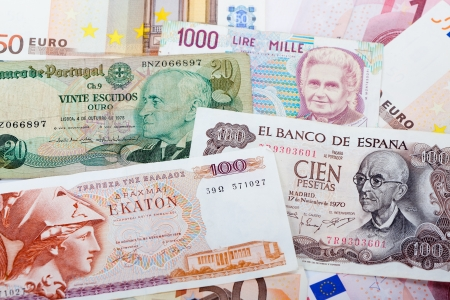 greek currency: Bank note of the former Greek currency Drachma, the Italian Lire, the Portuguese Escudo and the Spanish pesetas on a background of Euro bank notes.   As these countries are having financial problems, a return to the former currency is considered.