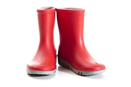 Pair of red wellies in kids size.   Studio shot, isolated on white background.