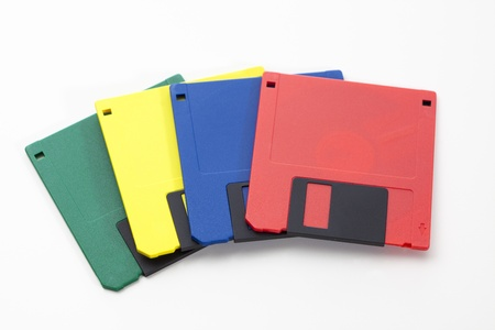 Set of floppy disks in 3.5 inch format with 1.44 MB capacity as commonly used in the late 80s/early 90s as storage medium for computer data.Studio shot, isolated on white background. Stock Photo - 17669922
