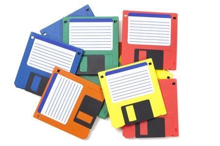 Set of floppy disks in 3.5 inch format with 1.44 MB capacity as commonly used in the late 80s/early 90s as storage medium for computer data.