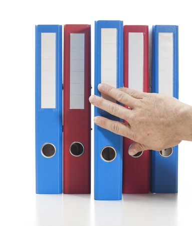 Set of binders in red and blue colors. Single hand pulling one of the binders