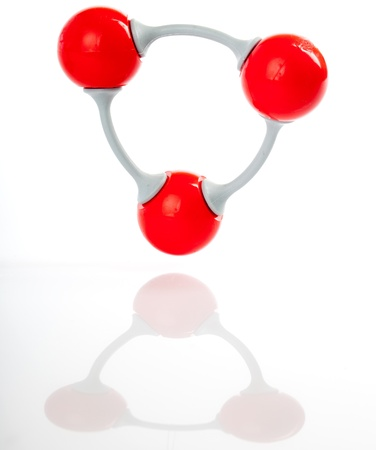 exact science: Molecule of ozone, molecular formula O3. Three oxygen molecules are connected to each other, opposed to the usual O2 oxygen molecule.  Shot with reflection on the ground.. Stock Photo