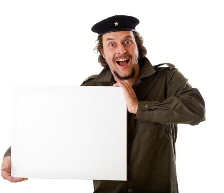 guerilla: Mid-aged man in authentic 1950s60s military uniform shirt and beret hat, holding a sign, ready for the next guerilla marketing campaign. :-)  Shot in studio on white background.. Stock Photo