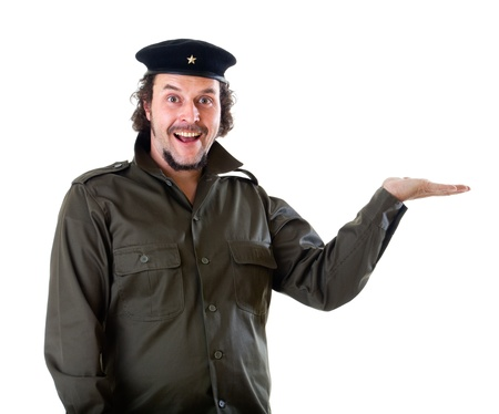 guerilla: Mid-aged man in authentic 1950s60s military uniform shirt and beret hat, holding his hands up to present any product.  Shot in studio on white background..