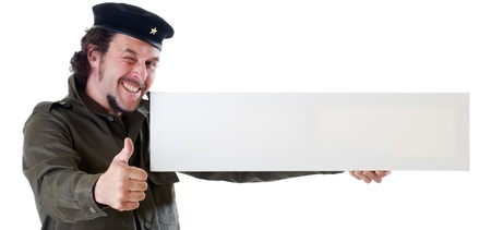 guerilla warfare: Mid-aged man in authentic 1950s60s military uniform shirt and beret hat, holding a wide sign, panoramic cut.  Shot in studio on white background..