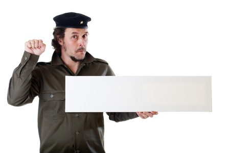 guerilla: Mid-aged man in authentic 1950s60s military uniform shirt and beret hat, holding a wide sign, panoramic cut.  Shot in studio on white background..