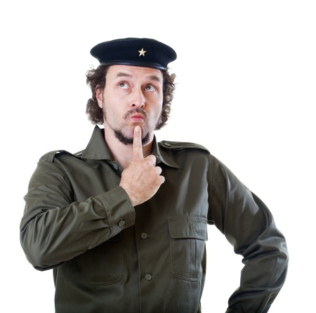 Mid-aged man in authentic 1950s60s military uniform shirt and beret hat, finger on his chin and eyes looking up like thinking about a difficult problem.  Shot in studio on white background.. Stock Photo