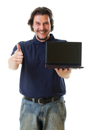 Mid-aged man smiling into the camera with his hands holding a netbook and showing thumbs up.