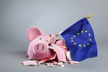 Broken piggy bank with EU flag - symbolic image for the financial crisis of the European Union.