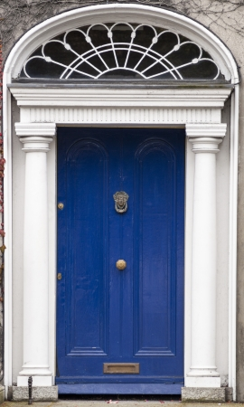 In the 18th century, during the Hanoverian period with British kings ruling the island, several streets and places in Dublin were redesigned. The houses at that time looked all very similar, so to differentiate the owners from their neighbours, the doors Stock Photo - 17669939