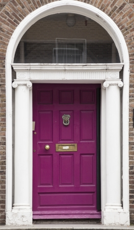 In the 18th century, during the Hanoverian period with British kings ruling the island, several streets and places in Dublin were redesigned. The houses at that time looked all very similar, so to differentiate the owners from their neighbours, the doors Stock Photo - 17669927