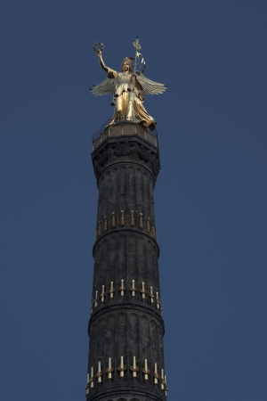 Golden statue on top of the Siegessaeule  Victory Column  in central Berlin  This column was built in the 1860s in memory of three wars won by the Prussian army  The depicted goddess Viktoria is nicknamed  Goldelse    Golden Elisabeth   by Berlin inhabita photo