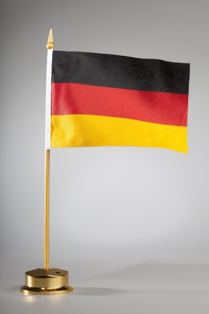German flag on a grey background  with center spot light on the background
