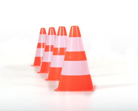 Four traffic cones in a row behind each other. 