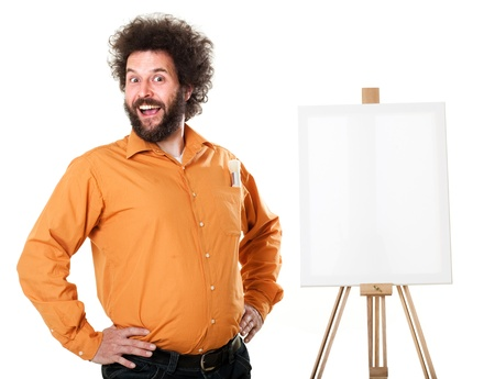 Guy in a bright, orange shirt, ready to paint, with a weird smile on his face.  Self portraits in studio, isolated on white.. Stock Photo