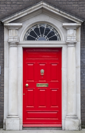 In the 18th century, during the Hanoverian period with British kings ruling the island, several streets and places in Dublin were redesigned. The houses at that time looked all very similar, so to differentiate the owners from their neighbours, the doors Stock Photo - 17669976
