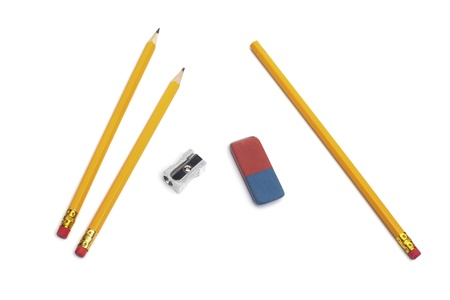 Three pencils with a sharpener and eraser rubber, isolated on white background photo