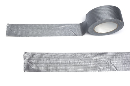 Gaffa tape, silver, from a roll and a stripe glued to the underground, isolated on white background Stock Photo