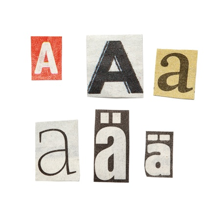 Set of letters cut out from different news papers and magazines as design elements.  Isolated on white background. Stock Photo