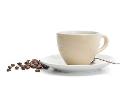 White cup with freshly brewed coffee and beans around. Isolated on white background. photo