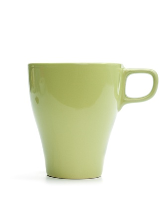 Green mug with freshly brewed coffee. Isolated on white background.