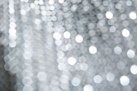 deliberately: Shiny blurred background with silver dots. Deliberately unfocused.