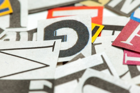 deliberate: Background of many different letters, cut out from news papers and magazines Deliberate shallow focus in the center  Stock Photo