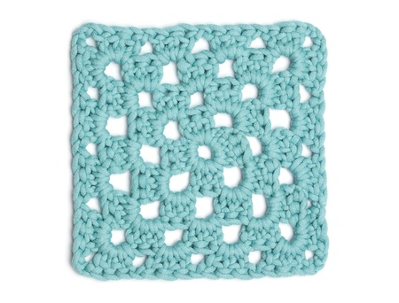Square of crochet doily in light blue wool.