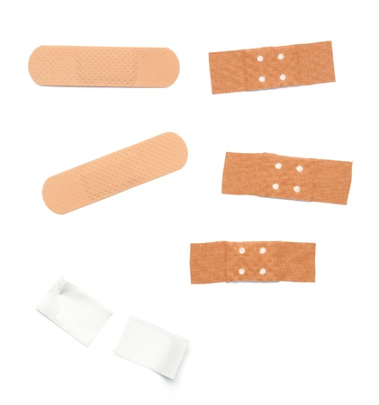 band aid: Set of band aids in different sizes, forms and colors. Isolated on white background.