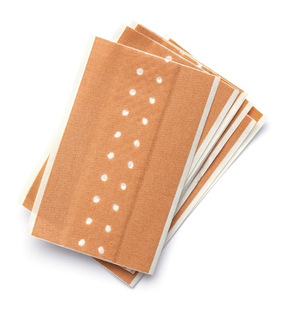 band aid: Bunch of band aids, plasters, for home use. Isolated on white background Stock Photo