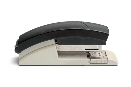 office stapler: Black stapler, office supply. Isolated on white background.