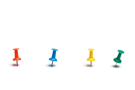Set of push pins in different colors, with real shadows, isolated on white background. Stock Photo