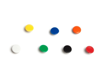 Set of thumb tacks in different colors, with real shadows, isolated on white background.