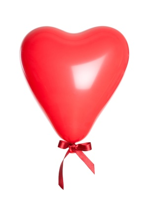 Red party balloon in heart shape, isolated on white background photo