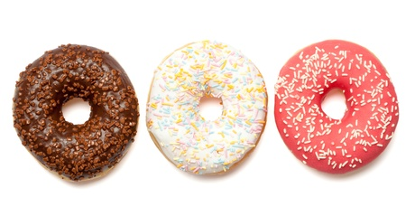Group of three donuts in white, pink and chocolate brown coatings and sprinkles. Isolated on white background. photo