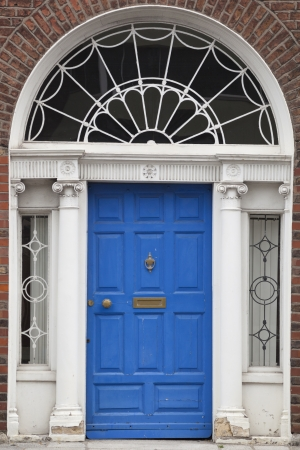 In the 18th century, during the Hanoverian period with British kings ruling the island, several streets and places in Dublin were redesigned. The houses at that time looked all very similar, so to differentiate the owners from their neighbours, the doors Stock Photo - 18929526
