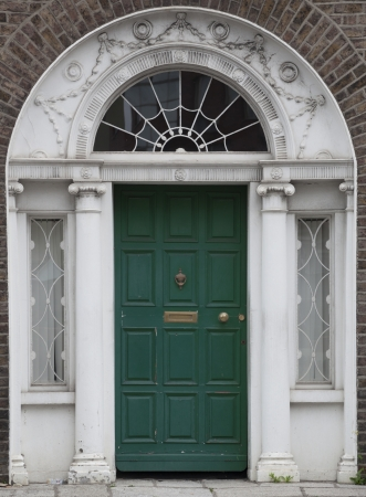 In the 18th century, during the Hanoverian period with British kings ruling the island, several streets and places in Dublin were redesigned. The houses at that time looked all very similar, so to differentiate the owners from their neighbours, the doors Stock Photo - 18929524