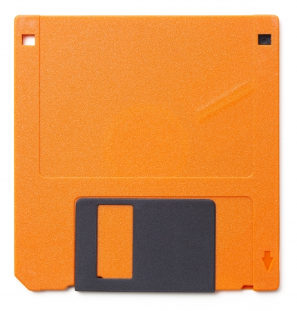 Set of floppy disks in 3.5 inch format with 1.44 MB capacity as commonly used in the late 80searly 90s as storage medium for computer data.  Studio shot, isolated on white background.