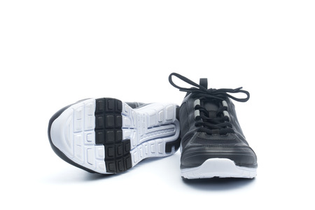 Pair of black sport shoes, sneakers, isolated on white background  photo