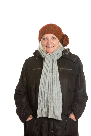 Senior Caucasion woman in winter clothing, portraits in studio isolated on white background photo