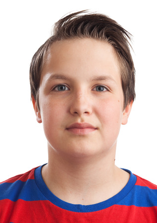 waist up: Waist up portrait of a teenager  13 years old  Caucasian boy, isolated on white background  Stock Photo